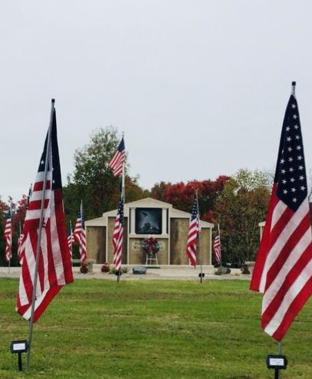 American Flags with Memorial in Background