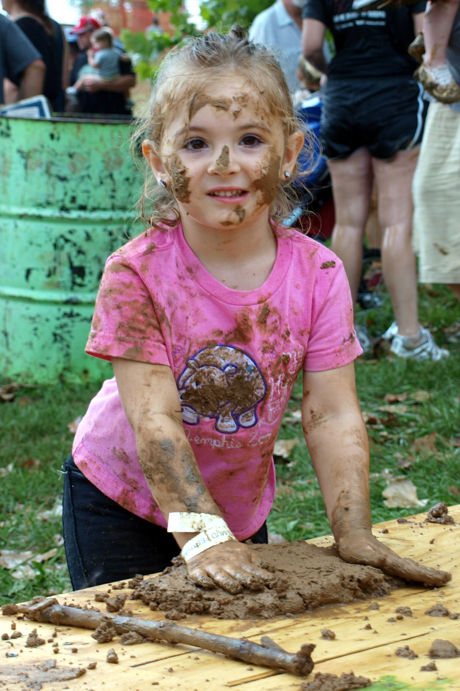 Girl making a mudpie