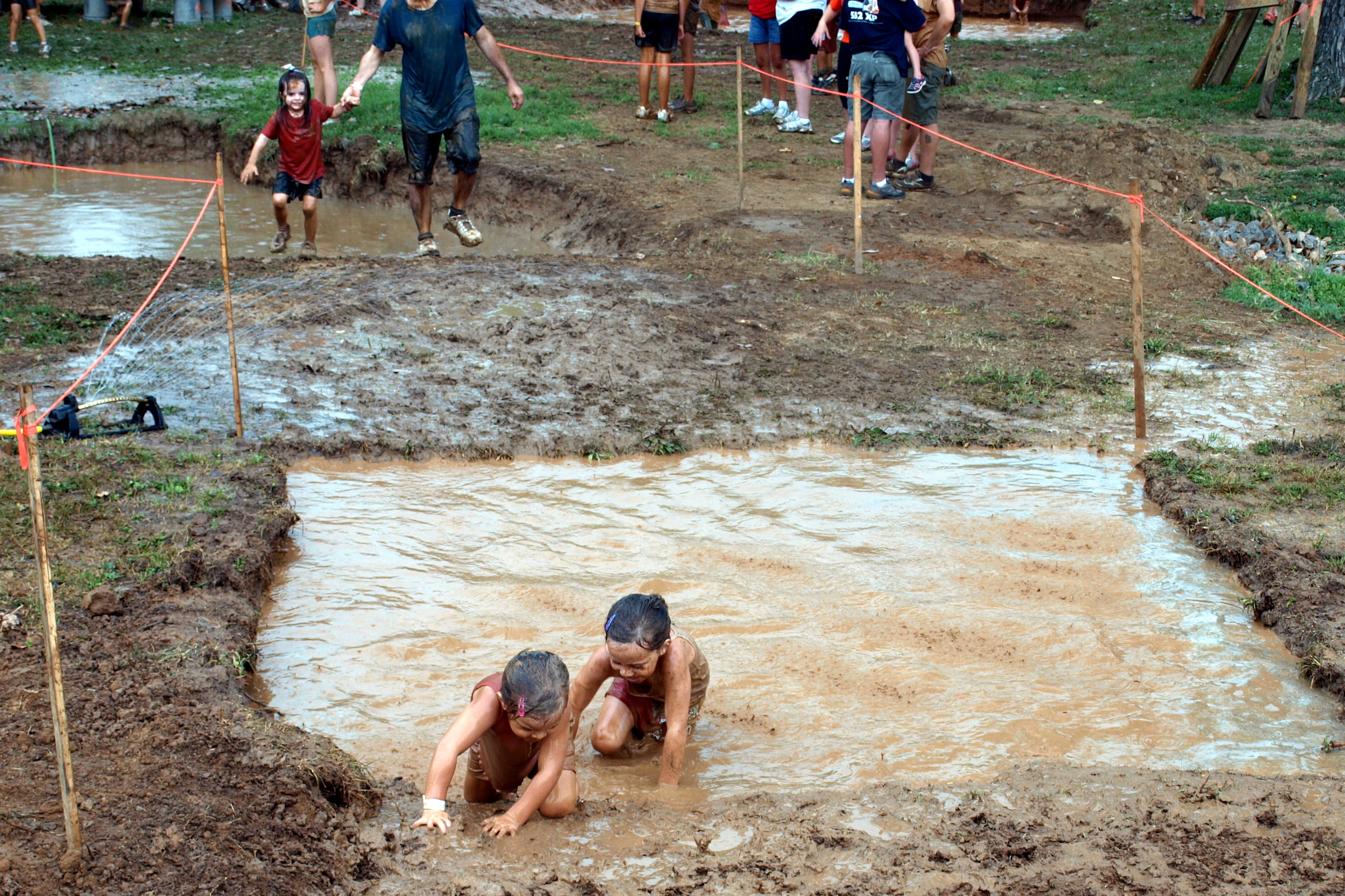 Kids playing in mudpit