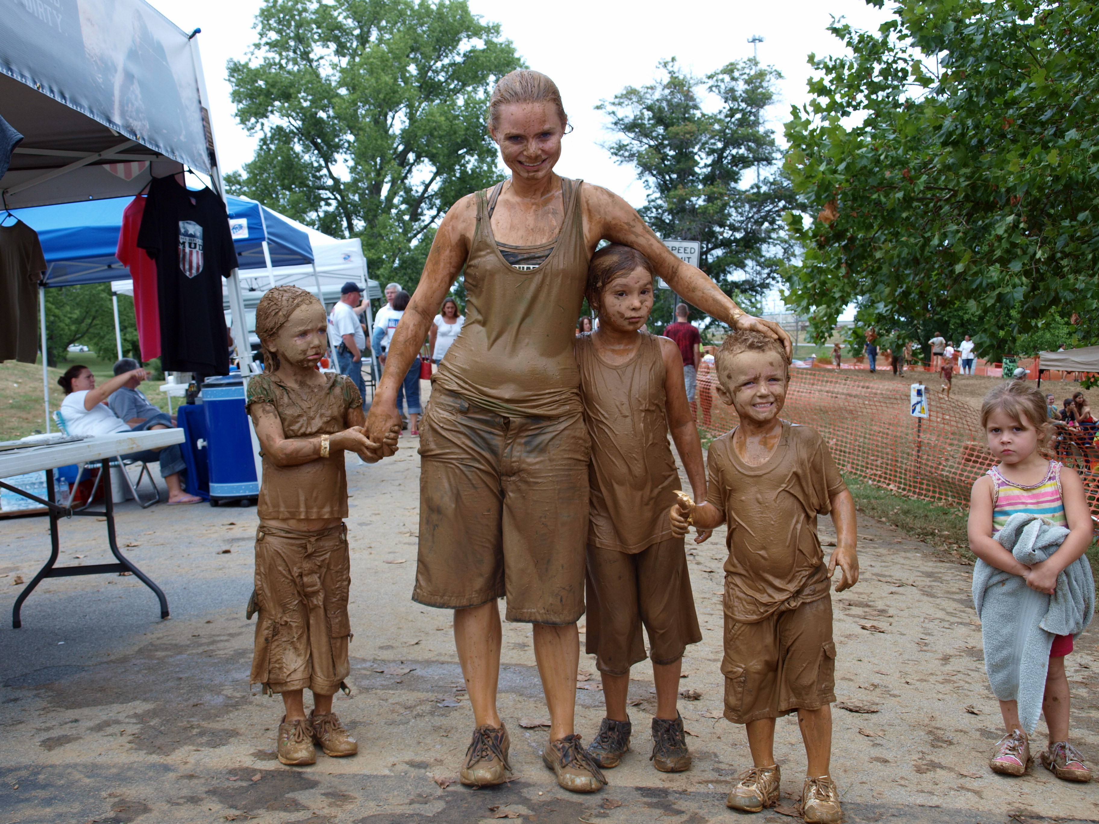 Family covered in mud