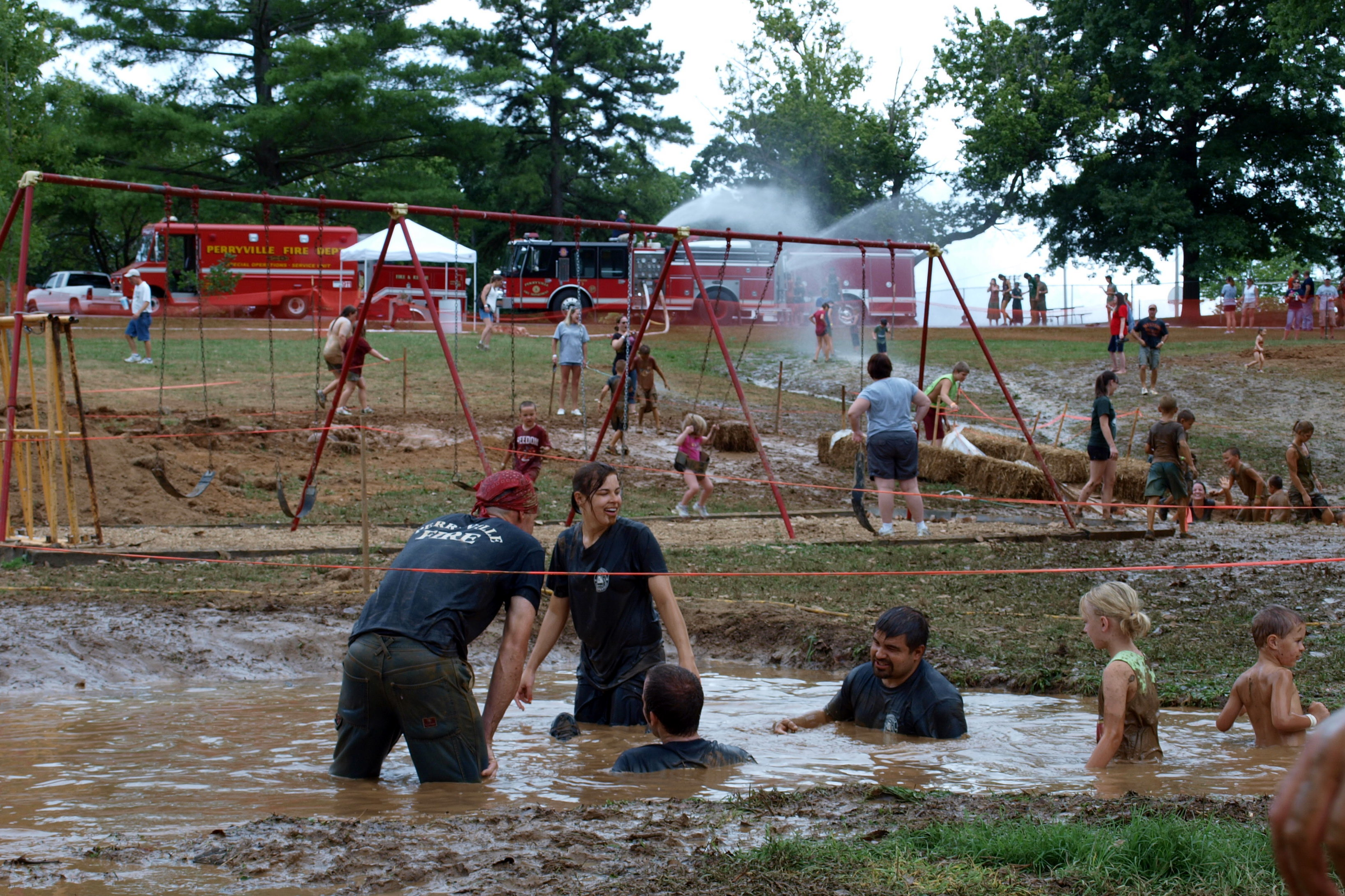 Adults playing in the mud